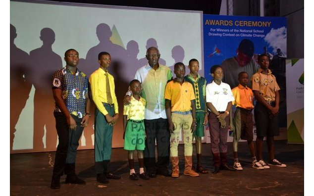 Former President John Kufuor and the awarded children